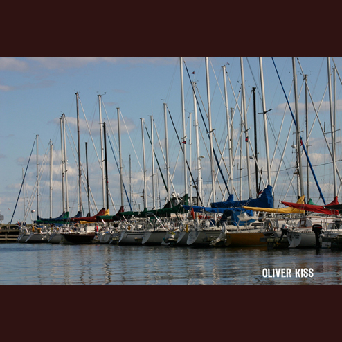 Lineup of sailboats at the Lachine docks.